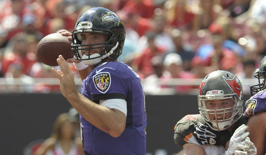 Baltimore Ravens quarterback Joe Flacco (5) throws a pass as he is pressured by the Tampa Bay Buccaneers defense during the first half of an NFL football game in Tampa, Fla., Sunday, Oct. 12, 2014. (AP Photo/Steve Nesius)