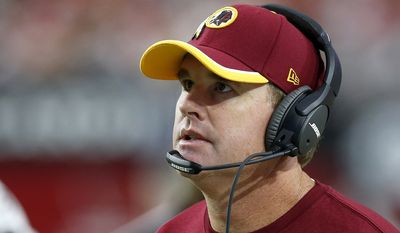 Washington Redskins head coach Jay Gruden paces on the sidelines during the second half of an NFL football game against the Arizona Cardinals Sunday, Oct. 12, 2014, in Glendale, Ariz.  The Cardinals defeated the Redskins 30-20. (AP Photo/Ross D. Franklin)