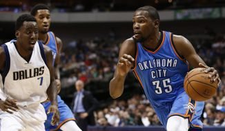 Oklahoma City Thunder forward Kevin Durant (35) drives to the basket in front of Dallas Mavericks forward Al-Farouq Aminu (7) during the first half of a preseason NBA basketball game, Friday, Oct. 10, 2014, in Dallas, Texas. (AP Photo/Jim Cowsert)