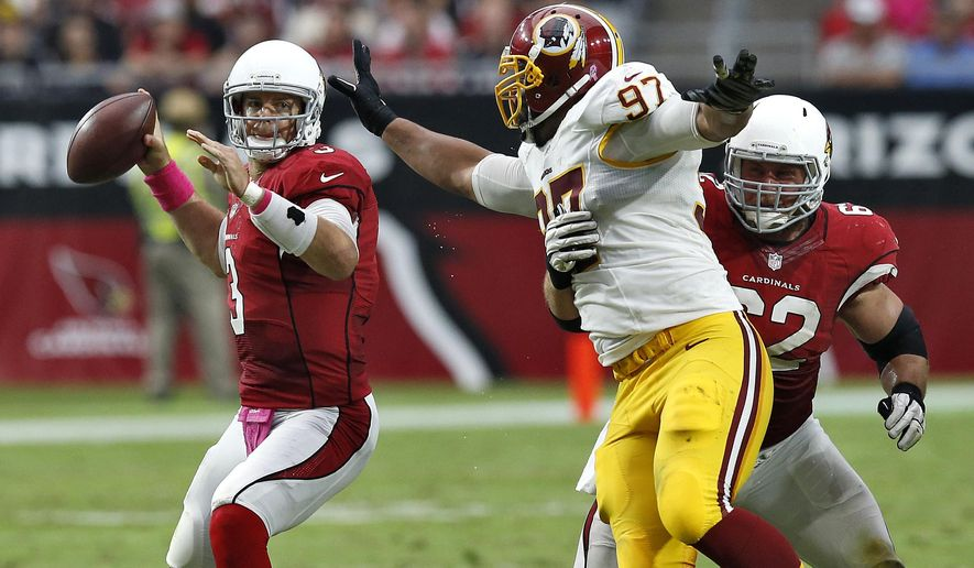 Arizona Cardinals quarterback Carson Palmer (3) throws as Washington Redskins defensive end Jason Hatcher (97) applies pressure during the second half of an NFL football game, Sunday, Oct. 12, 2014, in Glendale, Ariz. (AP Photo/Ross D. Franklin)