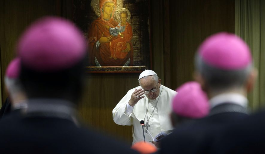 Pope Francis attends a morning session of a two-week synod on family issues at the Vatican, Monday, Oct. 13, 2014. (AP Photo/Gregorio Borgia)