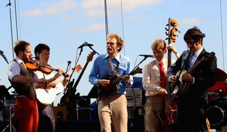 Gabe Witcher, Chris Eldridge, Chris Thile, Paul Kowert and Noam Pikelny of Punch Brothers perform in 2013 at the Lockn' Festival in Arrington Virginia. (Invision via ASsociated Press)