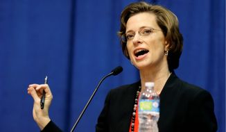 """""""This is probably one of the sharper contrasts that you will find between David [Perdue] and myself. I think David embraces what I believe is the attitude of gridlock in Washington that has not enabled us to get this done."""" — Michelle Nunn, the Democratic nominee for Senate in Georgia, said on the immigration stance of her opponent, Republican David Perdue. (Associated Press) **FILE**"""