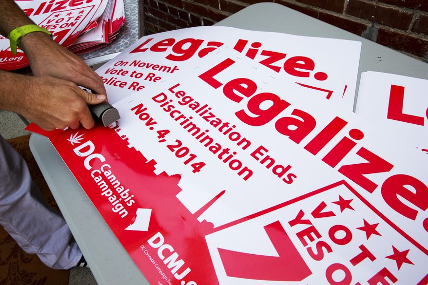 A DC Cannabis Campaign poster encourages people to vote yes on D.C. Ballot Initiative 71 to legalize small amounts of marijuana for personal use, in Washington. (AP Photo/Jacquelyn Martin)