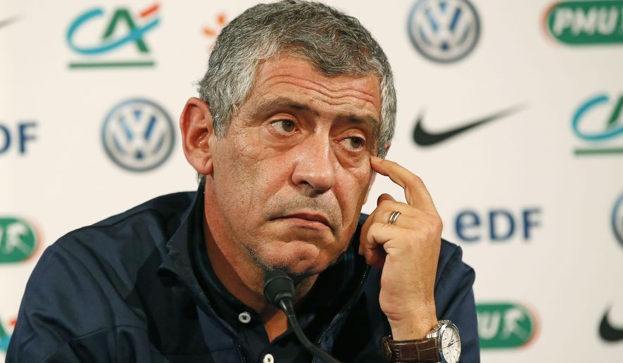 Portugal's head coach Fernando Santos, listens to a question from a journalist during a press conference ahead of a training session at Stade de France stadium in Saint Denis, outside Paris, France, Friday, Oct. 10, 2014. Portugal will face France in a friendly soccer match Saturday. (AP Photo/Michel Euler)