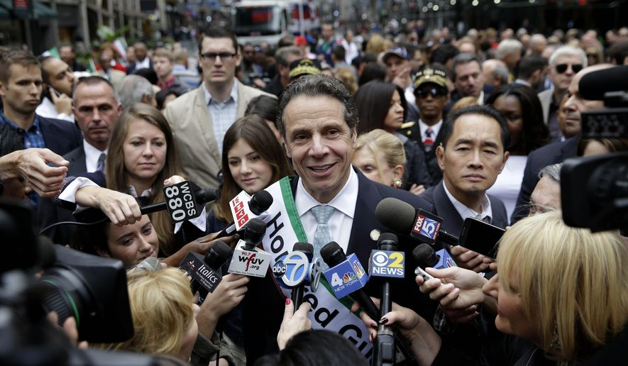 New York Gov. Andrew Cuomo talks with news media before marching in the Columbus Day parade in New York, Monday, Oct. 13, 2014. The parade is organized by the Columbus Citizens Foundation, and is billed as the world's largest celebrations of Italian-American heritage and culture. (AP Photo/Seth Wenig)