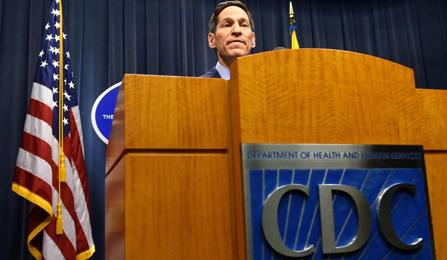 Centers for Disease Control (CDC) Director Tom Frieden provides an update on the latest developments involving the deadly Ebola virus and its infection of a Texas health care professional as he addresses the media during a briefing at CDC headquarters Monday, Oct. 13, 2014, in Atlanta. Frieden said the CDC is working to improve protections for hospital workers after a nurse caring for an Ebola patient in Dallas became the first person to become infected with the disease inside the U.S. (AP Photo/Atlanta Journal Constitution, David Tulis) MARIETTA OUT, GWINNETT OUT