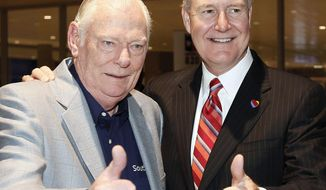 Southwest Airlines founder Herb Kelleher, left and Southwest CEO Gary Kelly give the thumbs up sign as they celebrate the end of the Wright Amendment at Love Field, in Dallas, Monday, Oct. 13, 2014. Limits on flights at Dallas Love Field died Monday after more than three decades, and Southwest Airlines Co. and Virgin America launched new long-haul service. (AP Photo/The Fort Worth Star-Telegram, Brandon Wade)  MAGS OUT; (FORT WORTH WEEKLY, 360 WEST); INTERNET OUT