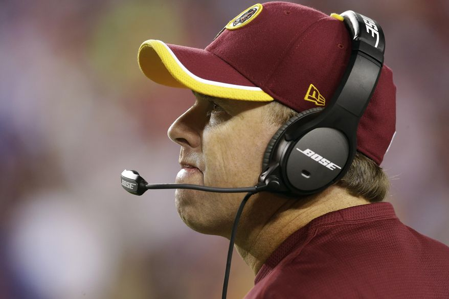 FILE - In this Sept. 25, 2014, file photo, Washington Redskins head coach Jay Gruden looks up at the scoreboard during the second half of an NFL Thursday night football game against the New York Giants in Landover, Md. Gruden knew there was work to do when he took over a Redskins team than went 3-13 last year.(AP Photo/Patrick Semansky, File)