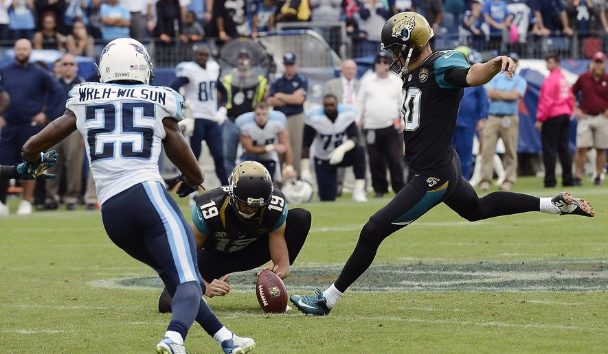 Jacksonville Jaguars kicker Josh Scobee (10) attempts a 55-yard field goal as Bryan Anger (19) holds and Tennessee Titans cornerback Blidi Wreh-Wilson (25) rushes in the final seconds of the fourth quarter of an NFL football game Sunday, Oct. 12, 2014, in Nashville, Tenn. The Titans blocked the kick to preserve a 16-14 win. (AP Photo/Mark Zaleski)
