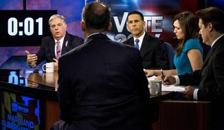 Maryland gubernatorial candidates Larry Hogan, left, speaks as Maryland Lt. Gov. Anthony Brown listens during the Maryland gubernatorial debate at News Channel 8 in Arlington, Va., Monday, Oct. 13, 2014. Brown and Larry Hogan spent much of their second debate trading accusations and focusing on weaknesses. (AP Photo/The Washington Post, Melina Mara, Pool)