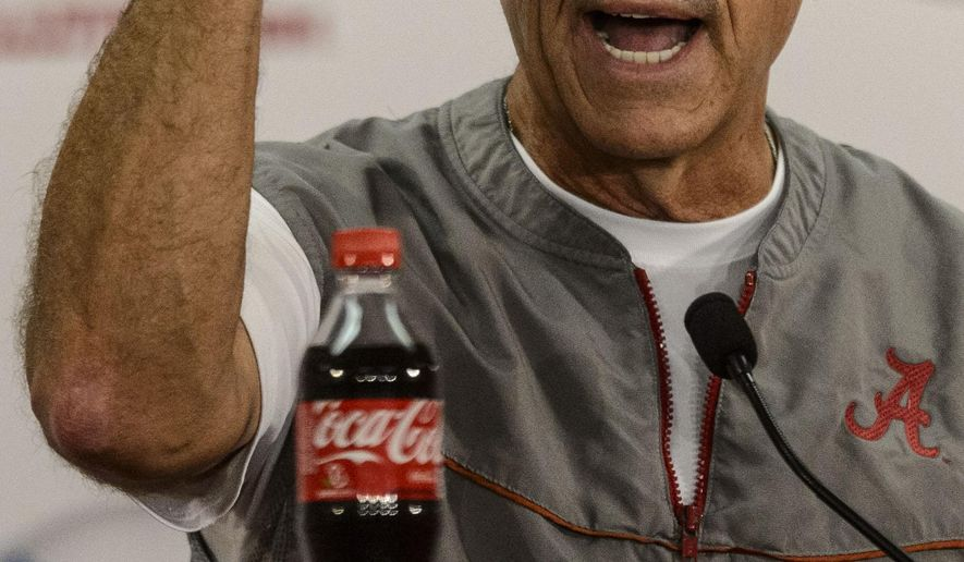 Alabama football coach Nick Saban talks with the media, Wednesday, Oct. 8, 2014, at the Naylor Stone Media Suite in the Mal Moore Athletic Facility in Tuscaloosa, Ala.   (AP Photo/AL.com, Vasha Hunt) MAGS OUT