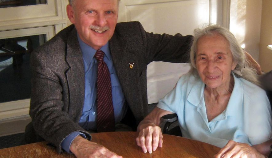 This November, 2012 photo provided by Jim Caccavo, left, shows him with his former neighbor Sarah Cheiker, then aged 89, in Freyberg, Maine. The elderly Los Angeles woman whose neighbors believed had died was instead found in a rundown shack in Maine, where according to authorities a family took her after gaining her confidence and selling her house. The Los Angeles Times reported the story of Cheiker, who disappeared in 2008 and was found in 2012 — alive but unwell. Investigators came across a missing person report filed by Caccavo. He figured Cheiker had died. Instead, according to authorities, a pair of twins and their godson swindled her into selling her home, then spent that money as they headed east. (AP Photo/Courtesy Jim Caccavo)