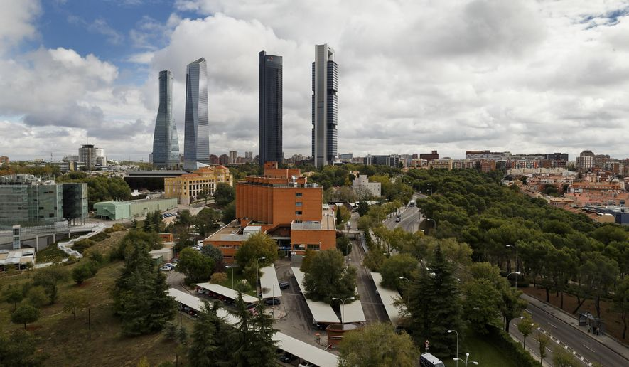 This general view shows the Carlos III Hospital, center, where a nurse infected with Ebola virus is being treated in Madrid, Spain, Monday, Oct. 13, 2014. Antonio Andreu director of the Madrid hospital treating Spain's Ebola patient says that tests carried out on assistant nurse Teresa Romero on Sunday showed the level of virus had diminished significantly but he warned there could be other complications and it is too risky to make predictions. The 15 people who came into contact with Romero and who are being monitored at the hospital have still not shown any symptoms. (AP Photo/Daniel Ochoa de Olza)