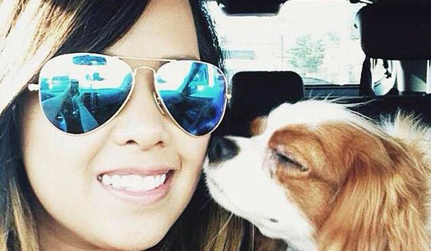 Nina Pham, 26, who contracted Ebola, is seen here in a Facebook photo with her beloved King Charles Spaniel, which is not expected to be euthanized but has been quarantined.