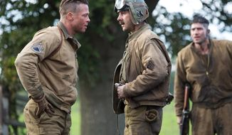 """This photo released by Sony Pictures Entertainment shows, Brad Pitt, left, as Wardaddy, and Shia LaBeouf as Boyd """"Bible"""" Swan, in a scene from Columbia Pictures' """"Fury."""" (AP Photo/Sony Pictures Entertainment, Giles Keyte)"""