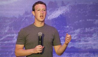 Facebook CEO Mark Zuckerberg delivers a speech during a workshop for application developers in Jakarta, Indonesia, Monday, Oct. 13, 2014. On his first visit to Facebook-crazy Indonesia, Zuckerberg met the president-elect, spread the word about his company's global Internet-access initiative and posted a photo of himself at an ancient Buddhist temple. (AP Photo/Achmad Ibrahim)