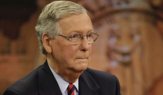 """U.S. Senate Minority Leader Mitch McConnell (R) Ky., rehearsed before the live broadcast  of """"Kentucky Tonight"""" with    Democratic opponent, Kentucky Secretary of State Alison Lundergan Grimes,  at KET studios in Lexington, Ky., Monday, Oct. 13, 2014. (AP Photo/The Lexington Herald-Leader, Pablo Alcala, Pool)"""