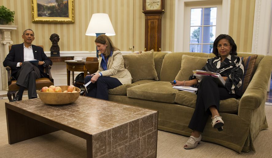 President Barack Obama meets with members of his public health and national security team about the response to the diagnosis of a second Ebola case in Dallas, Texas, Monday, Oct. 13, 2014, in the Oval Office of the White House in Washington. From left are. the president, Health and Human Services Secretary Sylvia Burwell, and National Security Adviser Susan Rice.  (AP Photo/Jacquelyn Martin)