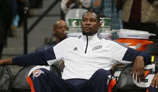 FILE - In this Oct. 8, 2014, file photo, Oklahoma City Thunder forward Kevin Durant sits before an exhibition NBA basketball game against the Denver Nuggets in Denver. Durant, the NBA's leading scorer of this decade and the reigning MVP, will likely miss the first six to eight weeks of the season after fracturing a bone in his right foot. The Oklahoma City star forward complained of an ache in his foot after practice Saturday, Oct. 11, 2014,  the team said. (AP Photo/David Zalubowski, File)