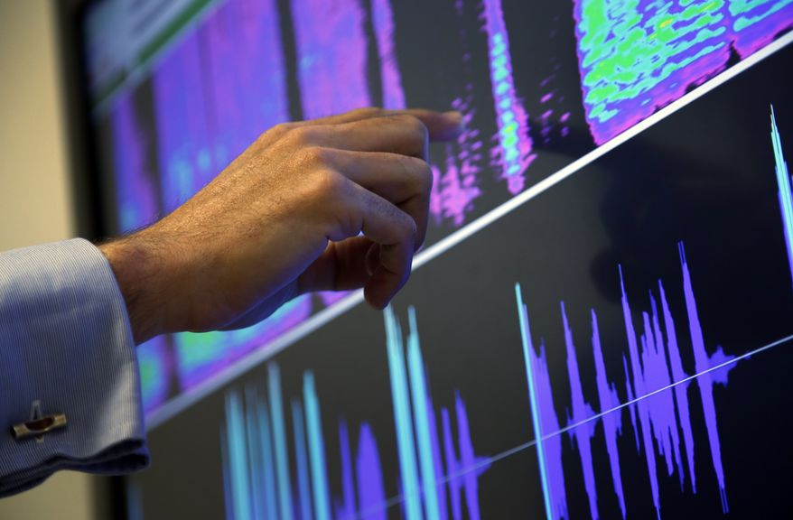 Benoit Fauve, a speech scientist with ValidSoft, points to a screen displaying the voice biometric features of a telephone call during a demonstration at the company's office in central London. An AP survey of the market found that more than 65 million people worldwide have had their voiceprints taken. And an Associated Press investigation has found that two of America's biggest retail banks, Chase and Wells Fargo, are quietly taking some callers' voiceprints to fight fraud. (Associated Press)