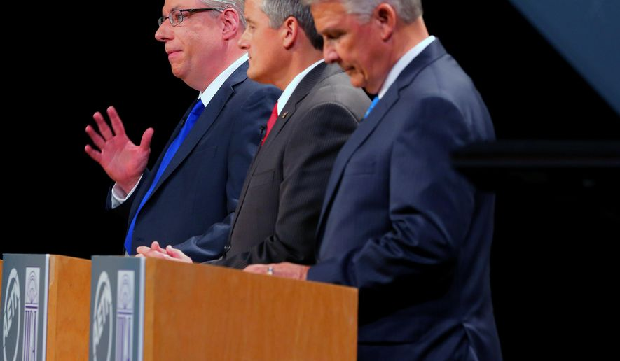U.S. Congressional District 4 candidate Ken Hamilton, left, answers  question as Bruce Westerman, center, and James Lee Witt, left, listen during a debate at the Reynolds Performance Hall on the University of Central Arkansas campus, Tuesday Oct. 14, 2014 in Conway, Ark. (AP Photo/The Arkansas Democrat-Gazette, Stephen B. Thornton)  ARKANSAS TIMES OUT; ARKANSAS BUSINESS OUT