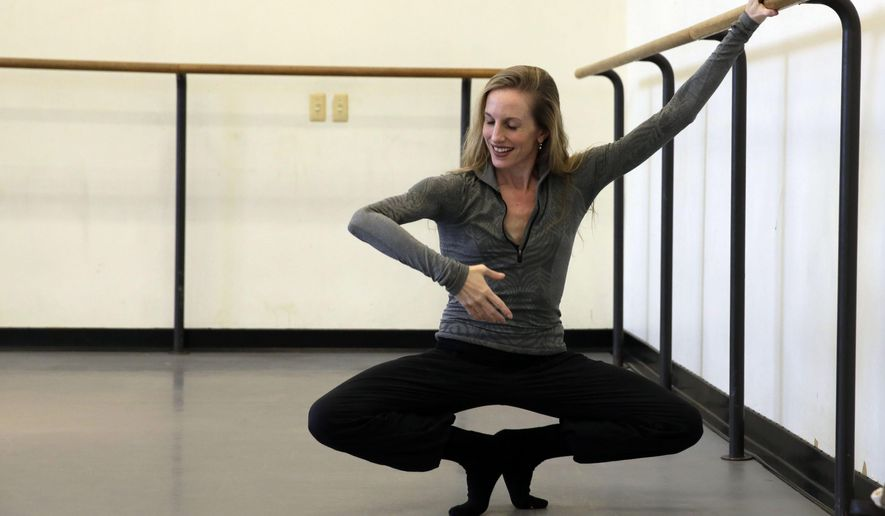 In this Oct. 3, 2014 photo, ballerina Wendy Whelan warms before a rehearsal, in the Rose Building of the Lincoln Center complex, in New York. After 30 years with City Ballet, Whelan dances her final performance Saturday, Oct. 18. (AP Photo/Richard Drew)