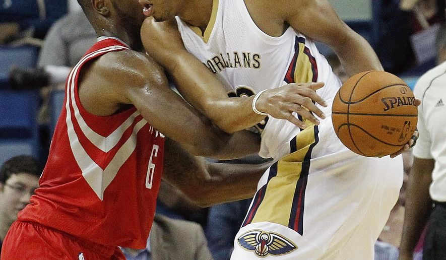 New Orleans Pelicans forward Anthony Davis, right, is fouled by Houston Rockets forward Terrence Jones (6) during the first half of an NBA preseason basketball game in New Orleans, Tuesday, Oct. 14, 2014. (AP Photo/Bill Haber)