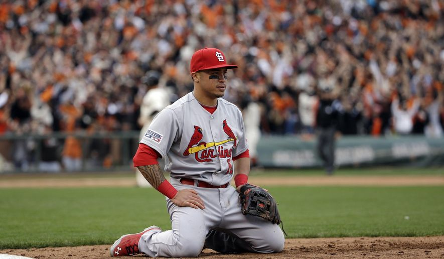 St. Louis Cardinals second baseman Kolten Wong sits in the dirt after the San Francisco Giants won Game 3 of the National League baseball championship series on a throwing error, Tuesday, Oct. 14, 2014, in San Francisco. (AP Photo/David J. Phillip)