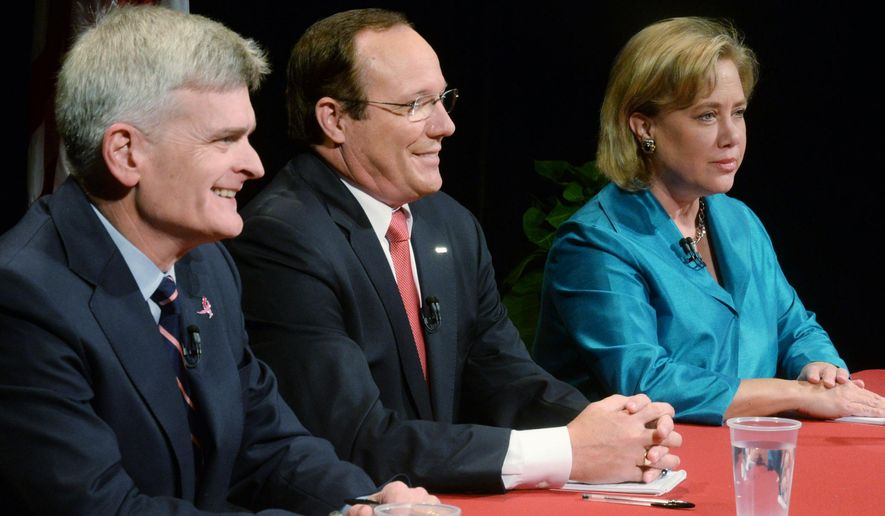 From left, Rep. Bill Cassidy, retired Air Force Col. Rob Maness, and Sen. Mary Landrieu wait moments before the debate, Tuesday, Oct. 14, 2014 at Centenary College in Shreveport, La. (AP Photo/The Shreveport Times, Henrietta Wildsmith)