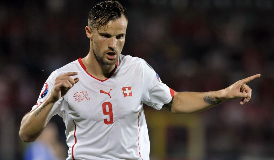 Switzerland's Hasir Seferovic celebrates after scoring during the Euro 2016, Group E qualifying soccer match between San Marino and Switzerland, at the Serravalle Stadium, San Marino, Tuesday, Oct. 14, 2014. (AP Photo/Marco Vasini)