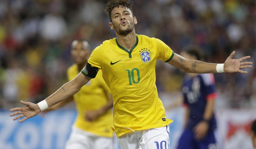 Brazil's Neymar celebrates  after scoring his fourth goal against Japan during an international friendly soccer match in Singapore, Tuesday, Oct. 14, 2014. (AP Photo/Wong Maye-E)