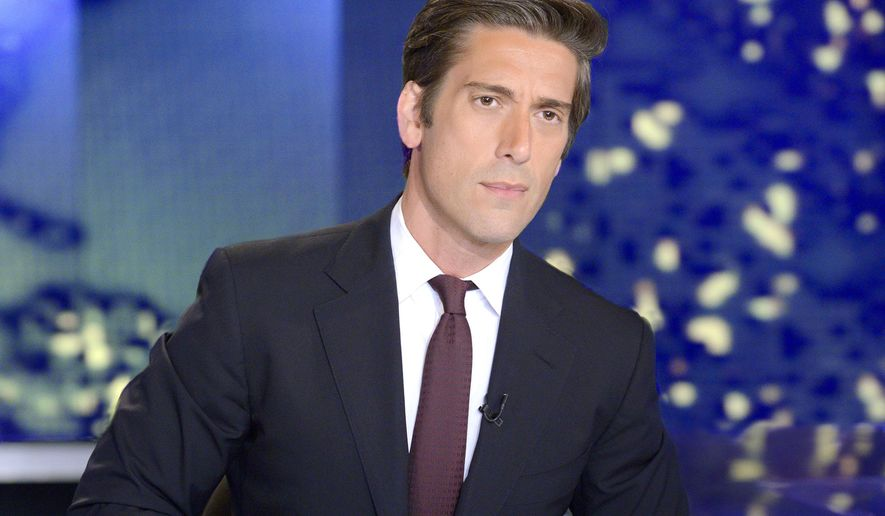 """In this image released by ABC News, anchor David Muir from """"World News Tonight with David Muir,"""" appears on the set in New York. The Nielsen company says ABC's evening newscast did not break a 263-week winning streak by its rivals at NBC, which had been reported last week. Nielsen found that NBC actually won the week by 170,000 viewers. (AP Photo/ABC, Lorenzo Bevilaqua)"""