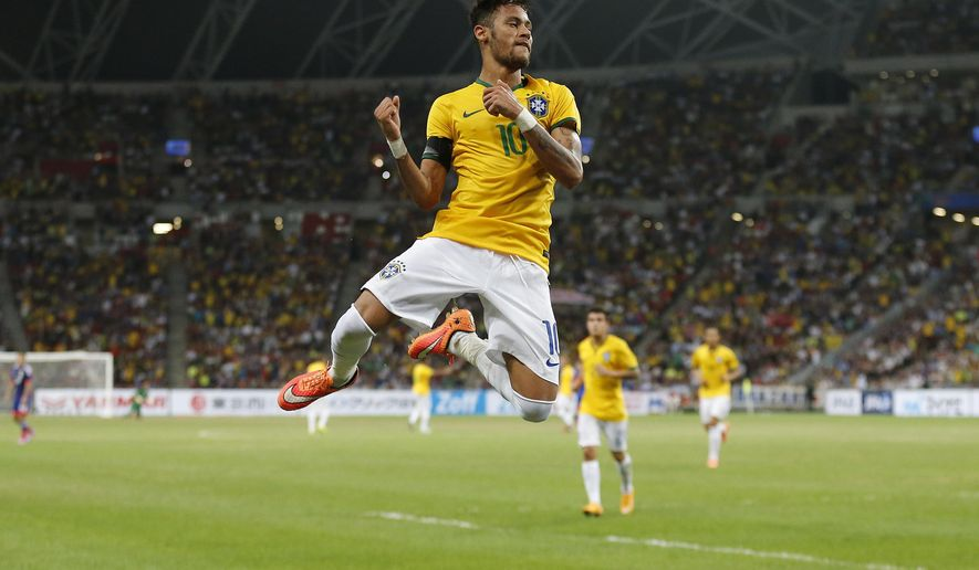 Brazil's Neymar celebrates after scoring the forth goal during an international friendly soccer match in Singapore, Tuesday, Oct. 14, 2014. (AP Photo/Wong Maye-E)