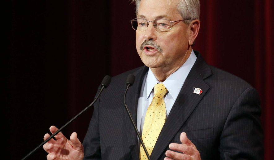 Republican Governor Gov. Terry Branstad speaks during a debate with Democrat Jack Hatch, Tuesday, Oct. 14, 2014 at the Orpheum Theatre in Sioux City, Iowa. (AP Photo/The Sioux City Journal, Jim Lee) MAGS OUT; NO SALES; TV OUT; MANDATORY CREDIT