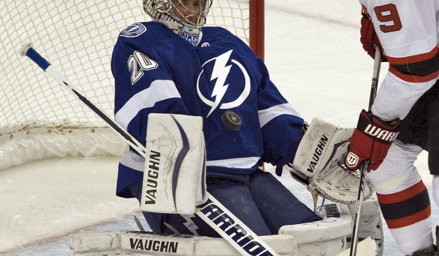Tampa Bay Lightning goalie Ben Bishop stops a shot from New Jersey Devils' Martin Havlat (9) during the period of an NHL hockey game Tuesday, Oct. 14, 2014, in Tampa, Fla. (AP Photo/Steve Nesius)