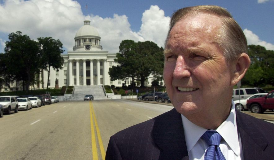 FILE - In this June 9, 2005, file photo, political powerhouse AEA Executive Secretary Dr. Paul Hubbert stands on Dexter Avenue in Montgomery, Ala., with the State Capitol  behind him. The powerful Alabama teacher lobbyist and former gubernatorial candidate has died. He was 78. A spokeswoman for the Alabama Education Association said Hubbert died Tuesday, Oct. 14, 2014, at a Montgomery hospital. Spokeswoman Amy Marlowe said he was hospitalized Oct. 6 after a fall and died from complications. (AP Photo/Kevin Glackmeyer, File)