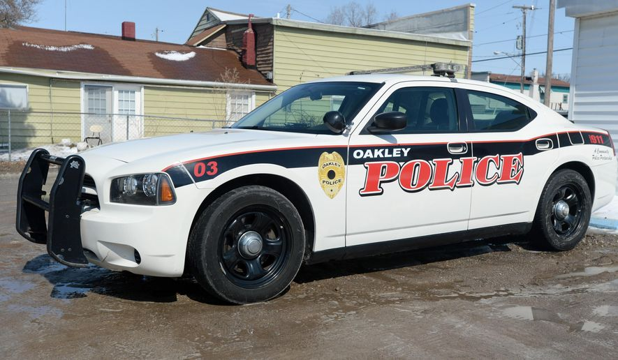 This March 14, 2014 file photo shows a police car in Oakley, Mich. An Oakley village trustee plans to move to have police reservists return their badges and all other police equipment to the village, The Saginaw News reported. (AP Photo/The Saginaw News, Jeff Schrier, File) ALL LOCAL TV OUT; LOCAL TV INTERNET OUTFILE -