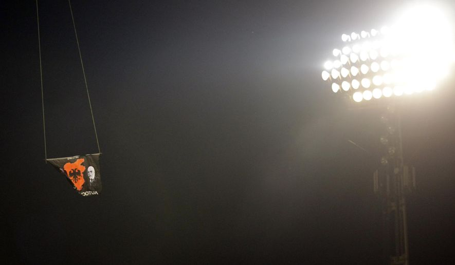 A drone with an Albanian flag banner flies over Partizan stadium during the Euro 2016 Group I qualifying match between Serbia and Albania in Belgrade, Serbia, Tuesday, Oct. 14, 2014. The match was abandoned. (AP Photo/Darko Vojinovic)