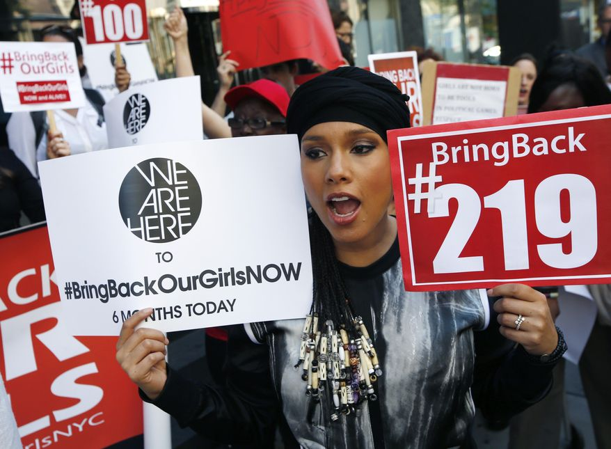 """Singer-songwriter Alicia Keys joins protesters with the """"Bring Back Our Girls"""" campaign in front of the Nigerian consulate in New York, Tuesday, Oct. 14, 2014, marking the six month anniversary of the kidnapping of over 200 Nigerian schoolgirls. Protesters in Nigeria were set to march on the presidency calling for the release of 219 Nigerian schoolgirls kidnapped by Boko Haram militants. (AP Photo/Kathy Willens)"""
