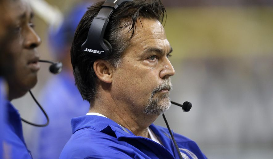 St. Louis Rams head coach Jeff Fisher watches from the sideline in the first quarter of an NFL football game against the San Francisco 49ers Monday, Oct. 13, 2014, in St Louis. (AP Photo/Scott Kane)