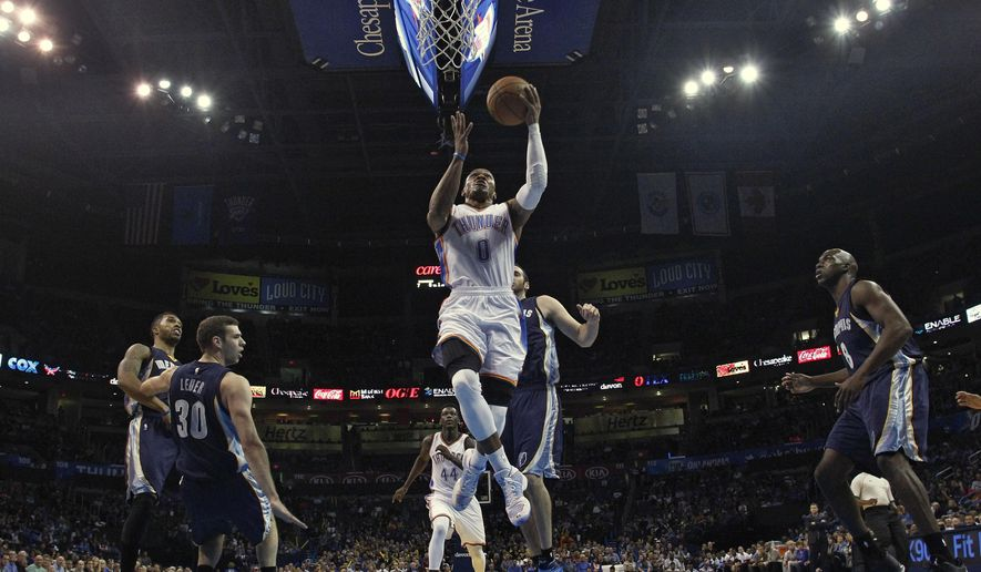 Oklahoma City Thunder guard Russell Westbrook (0) goes up for a shot in the first quarter of an NBA basketball pre-season game against the Memphis Grizzlies in Oklahoma City, Tuesday, Oct. 14, 2014. (AP Photo/Sue Ogrocki)