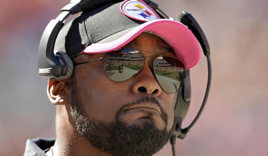 Pittsburgh Steelers head coach Mike Tomlin watches from the sidelines in the first quarter of an NFL football game against the Cleveland Browns, Sunday, Oct. 12, 2014, in Cleveland. (AP Photo/David Richard)