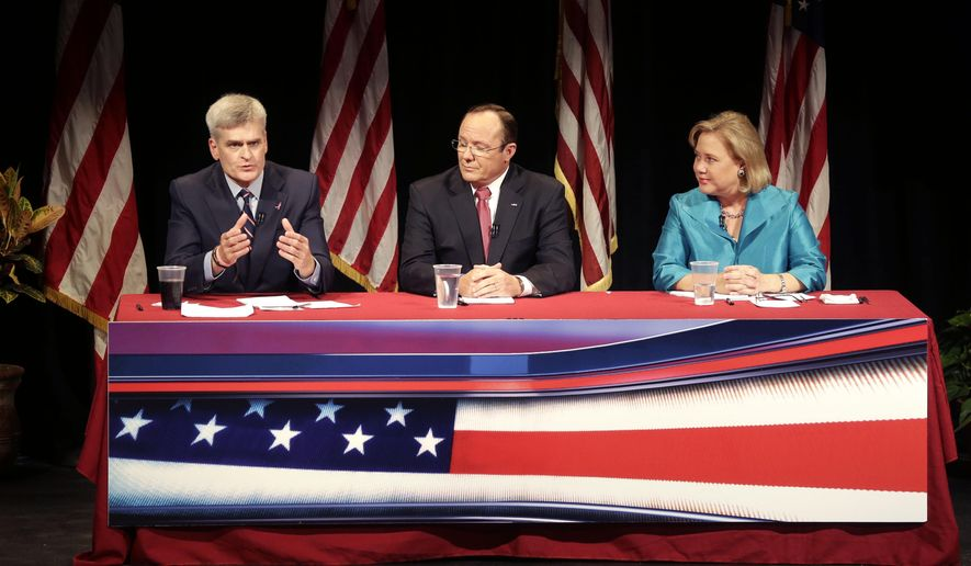 RETRANSMISSION TO CORRECT RIGHT TO LEFT - Sen. Mary Landrieu, D-La., right, Senate candidate, Rep. Bill Cassidy, R-La., left, and Republican candidate Rob Maness participate in a debate at Centenary College in Shreveport, La., Tuesday, Oct. 14, 2014. (AP Photo/Gerald Herbert)