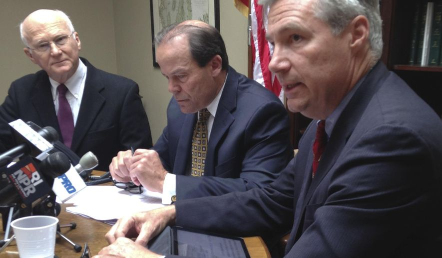 """U.S. Sen. and former U.S. attorney Sheldon Whitehouse, right, former U.S. Attorney Robert Clark Corrente, center, and Phil West, retired head of the government watchdog group Common Cause of Rhode Island, speak to media in Providence, R.I., Tuesday, Oct. 14, 2014, about the candidacy of former Providence Mayor Buddy Cianci. They called a possible third Cianci administration an """"alarming prospect"""" and said there's no reason to believe Cianci has changed after two felony convictions. (AP Photo/Jennifer McDermott)"""