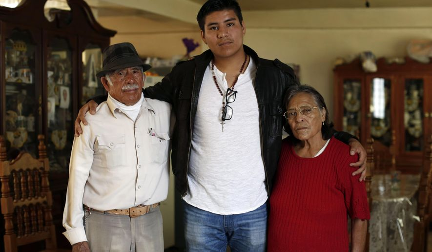 In this Friday, Oct. 3, 2014 photo, Dario Guerrero, center, poses for a portrait with his grandparents Dario Guerrero Garrido and Crescencia Garcia Vazquez at their home in the outskirts of Mexico City. Guerrero, a Harvard University junior, accompanied his dying mother to Mexico without government permission, and is now unable to return to the United States. (AP Photo/Dario Lopez-Mills)