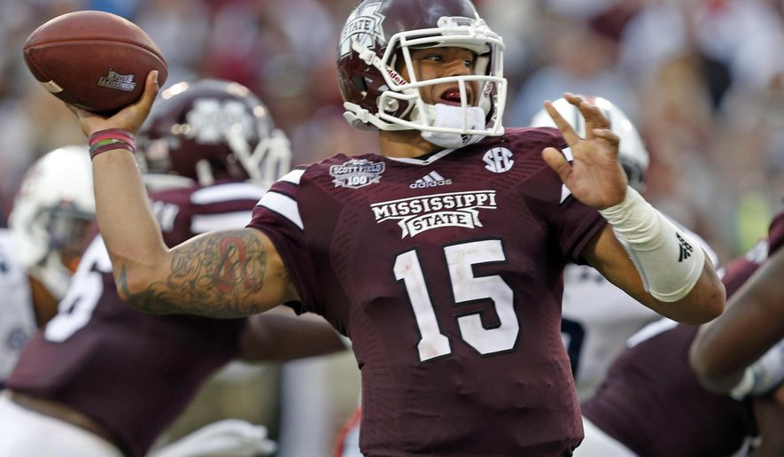 Mississippi State quarterback Dak Prescott (15) throws a pass during the first half of an NCAA college football game against Auburn  in Starkville, Miss., Saturday, Oct 11, 2014.  (AP Photo/Rogelio V. Solis)