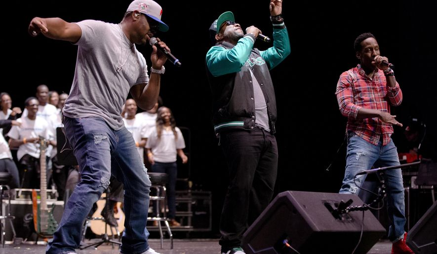 "Nathan Morris, from left, Wanya Morris, and Shawn Stockman of the musical group Boyz II Men, perform at their alma mater, Creative and Performing Arts High School, Tuesday, Oct. 14, 2014, in Philadelphia. The Grammy-winning R&B group, best known for '90s hits like ""I'll Make Love To You"" and ""Motownphilly,"" is set to release their new album, ""Collide,"" next week. (AP Photo/Matt Rourke)"