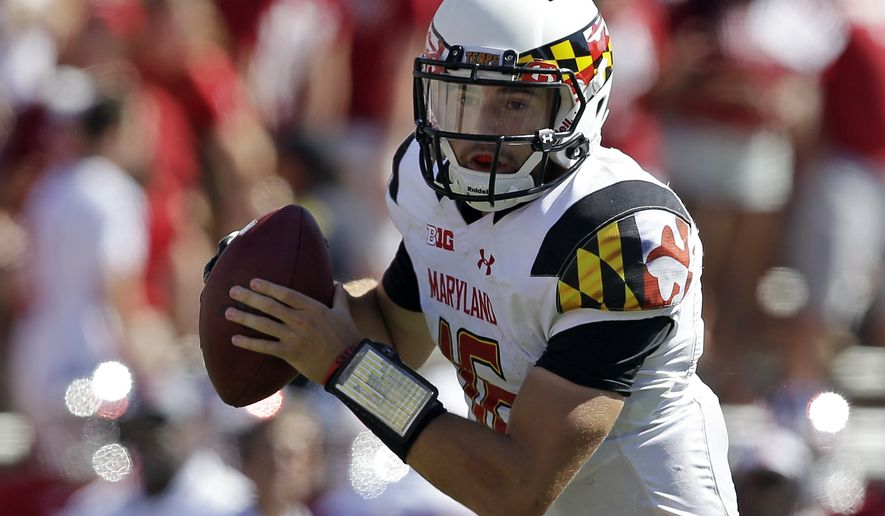 Maryland quarterback C.J. Brown takes the snap and run five yards for a touchdown during the first half of an NCAA college football game against Indiana, Saturday, Sept. 27, 2014, in Bloomington, Ind. (AP Photo/Darron Cummings)