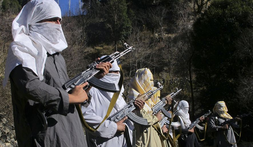 In this Sunday, Dec. 11, 2011, file photo, masked Pakistani Taliban militants take part in a training session in an area of Pakistan's tribal South Waziristan region along the Afghan border. (AP Photo/Ishtiaq Mahsud, File)